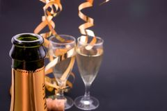 New year's toast. Champagne glasses and bottle, with copyspace Stock Image