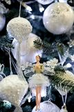 New Year`s toy in the image of Thumbelina is on the Christmas Tree. Balloons royalty free stock photos