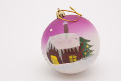 New Year's toy - a sphere with house. And fur-tree drawing royalty free stock image