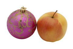 New Year's toy and yellow apple isolated. New Year's toy and yellow apple on the white background stock images