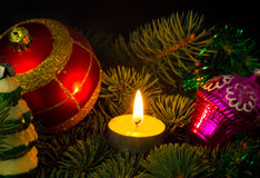 New Year's toys. Christmas tree decorated with New Year's toys and candles Stock Photography