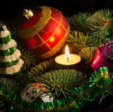 New Year's toys. Christmas tree decorated with New Year's toys and candles Stock Images