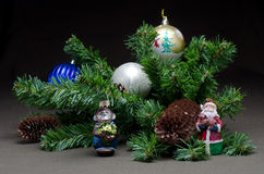 The New year's toys on background fir tree. The New year's toys on dark background with fir tree Royalty Free Stock Photos