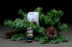 The New year's toys on background fir tree. The New year's toys on dark background with fir tree Royalty Free Stock Images