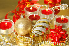 New Year`s toys, burning candles and serpentine Stock Photo