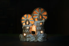 New Year's toys with candles. Against a dark background Royalty Free Stock Photo