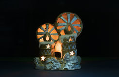 New Year's toys with candles. Against a dark background Royalty Free Stock Image