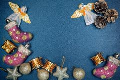 New Year`s toys on a dark table. Royalty Free Stock Photo
