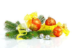 New Year's toys and fur-tree branch. On a light background Royalty Free Stock Photography