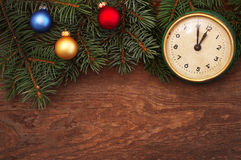 New Year's toys and old hours on a wooden background Royalty Free Stock Photography