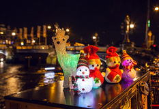 New Year`s toys snowmen and deer pose against night canals of Amsterdam. Stock Image