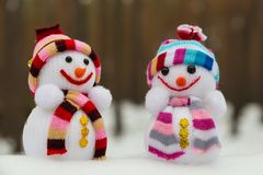 New Year`s toys - two snowmen in the snow Stock Photo