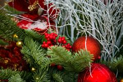 New Year`s tree, decorated with golden and red balls, beads and tinsel. New Year`s tree, decorated with golden and red ball, beads and tinsel Royalty Free Stock Image