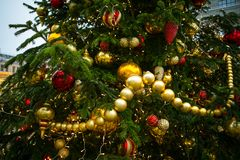 New Year`s tree, decorated with golden and red balls, beads and tinsel. New Year`s tree, decorated with golden and red ball, beads and tinsel Stock Photos