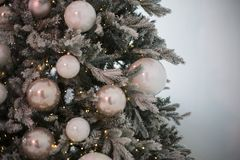 The New Year`s tree with multi-colored spheres which hang on it and flickers a garland royalty free stock photo