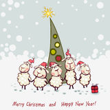 New Year's tree with ram. New Year's card. Ram and goat decorating christmas tree Stock Photo