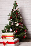 New Year's tree with toys and gifts Royalty Free Stock Photography