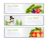 New Year's visit card. Set New Year's visit card with snowmen, Christmas trees, gifts and spruce branches Stock Photo
