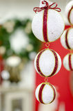 New Year's white ball with red ribbon Royalty Free Stock Images