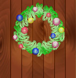 New Year's wreath from fir-tree branches. On wooden texture Stock Images