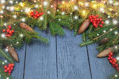 New Year`s wreath from a green Christmas tree with cones on a wo. Oden Royalty Free Stock Image