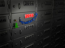 2015 New Year (safe deposit box). 2015 New Year concept: safe deposit box with luminous date and holiday attributes (Christmas tree, blue ribbon) as symbol of Royalty Free Stock Image