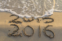 New year. Sea wave erasing 2015 on the shore Royalty Free Stock Image