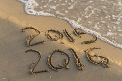 New year. Sea wave erasing 2015 on the shore Stock Photo