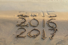 New year. Sea wave erasing 2015 on the shore Stock Photography