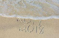 New year 2018 in seashore sand Stock Photos