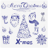 2015 New year set label Hand Drawn on a school notebook backgrou. Nd. Vector illustration Christmas calligraphic inscription, Christmas tree, Santa Claus Stock Photo