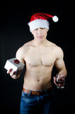 New Year. Sexy guy and a gift. Royalty Free Stock Photos