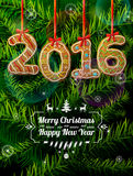 New Year 2016 in shape of gingerbread against pine branches Stock Images