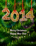 New Year 2014 in shape of gingerbread against pine Royalty Free Stock Images