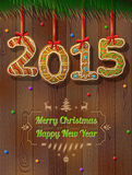 New Year 2015 in shape of gingerbread against wood background Royalty Free Stock Photos