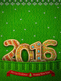 New Year 2016 in shape of gingerbreads in knitted pocket Stock Image