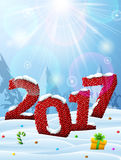 New Year 2017 in shape of knitted fabric in snow Royalty Free Stock Images