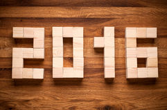 2016 New Year in shape from wooden cubes. Royalty Free Stock Images