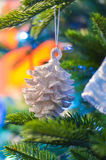 New Year shine cone. New Year  toy on the new year tree Stock Images