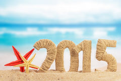 New year 2015 sign. On the beach royalty free stock photo