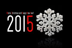 New year 2015 sign with christmas snowflake toy on. Black background. Happy new year card stock illustration
