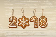 2018 New Year sign made of ginger cookies with vintage strings on wooden background. Vector 2018 New Year design Royalty Free Stock Photo