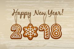 2018 New Year sign made of ginger cookies with vintage strings on wooden background. Vector 2018 Happy New Year design Royalty Free Stock Photography