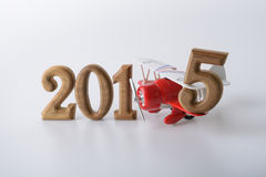 New year 2015 sign made by wooden number and toy airplane. New year 2015 sign made by wooden number and red toy airplane Royalty Free Stock Photography
