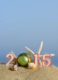 New year 2015 sign with seashells, starfish and christmas ball Royalty Free Stock Image