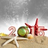 New year 2015 sign with seashells, starfish and christmas ball Stock Photos