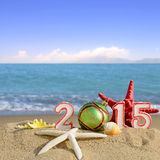 New year 2015 sign with seashells, starfish and christmas ball Royalty Free Stock Photography