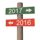 New Year 2017 sign. Wooden road signpost points to the New Year 2017 and the Old Year 2016. 3d illustration Stock Photos