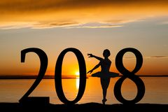 2018 New Year Silhouette of Ballet Girl at Golden Sunset. 2018 New Year silhouette of a girl dancing ballet at the beach during golden sunrise or sunset with Royalty Free Stock Photography