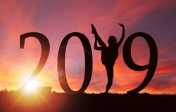 2019 New Year Silhouette of Girl Dancing at Golden Sunrise stock photos